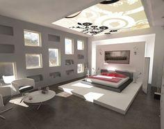 Esto es el dormitorio de Isabelle. Es un habitación grande y espaciosa. La cama está situada encima de una tarima blanca y es un tatami de color gris,en su parte izquierda hay un radiador de diseño moderno y encima de la cabecera de la cama un bonito cuadro. En la pared gris hay pequeñas ventanas y estantes de forma rectangular. A los pies de la cams hay una mesa de café con 2 sillas blanca y grises. La iluminación es en forma floreal y consta de 2 lámparas de mesa y 2 apliques a ambos lados…