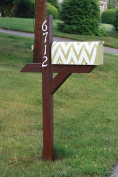 DIY Chevron Mailbox:  •Painted the post with outdoor paint.  •Spray-painted the numbers with Rustoleum flat-finish paint.  •Spray painted the mailbox white with Rustoleum flat-finish paint.  •Taped-off the pattern using Frog Tape.  •Painted the zig-zags using outdoor paint.  •Let it dry for a few hours before hanging it back on the post.  I think the mail carrier will be impressed!