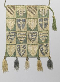 1300-1350, England or France. Purse embroidered with English and French coats of arms, linen embroidered with silk and gold and lined with blue linen. Done in long arm cross stitch.