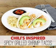 """<a href=""""http://www.theshabbycreekcottage.com/2013/10/chilis-spicy-grilled-shrimp-tacos.html"""" target=""""_blank""""><strong>Chili's Inspired Spicy Grilled Shrimp Tacos from The Shabby Creek Cottage</strong></a>"""