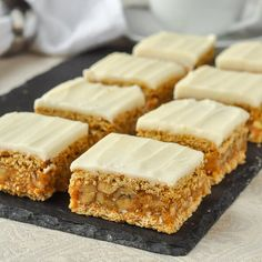 Walnut Oh Henry Bars. A scrumptious no-bake cookie bar with a caramely, nutty centre sandwiched between graham crackers and topped with sweet vanilla buttercream frosting.