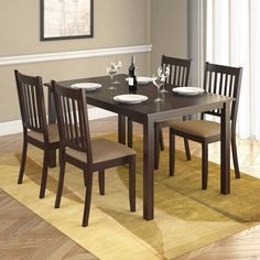 Add comfort to your dining room with this practical and transitionally styled dining set from CorLiving. This set includes four chairs with Beige microfiber upholstered seats and a wood table constructed of hardwood and wood composites.