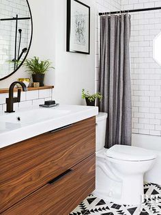 From outdated to a contemporary masterpiece, this bathroom makeover is seriously impressive.