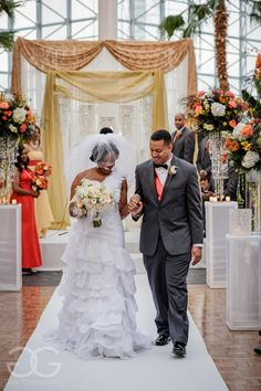 photo of bride and groom walking down aisle together after wedding ceremony in crystal gardens http://corlisandmegangray.com