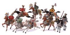 """Heyde No """"0"""" [70mm] size solids made prior to 1945 by Georg Heyde of Dresden, Germany, comprising: Ritter auf Pferden [Mounted Knights] - 2 x Knights on Standing Horses, 2 x Knights on Walking Horses & 4 x Knights on Galloping Horses. Each is depicted in Full Armour with Hinged Visors, Shields & Various Weapons. The Horses have Separate Saddles. Some minor damages & paint loss otherwise generally Good overall. Rare. [24 pieces]"""