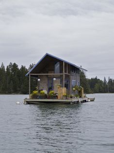carolina-lion:  cabin. Hand-built floating cabin in Perry Creek, on the island of Vinalhaven, Maine. Photographed by Marcus Peabody.  It's a floating cabin. In Maine. With flowers and chairs on the front porch……