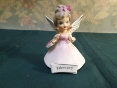 "For sale is a vintage February birthday angel made by Nanco of Boston, MA. The angel measure 4 1/4 "" high x 3"" long base, and is in fine used condition with no chips or cracks, has original silver foil stickers, scuff marks from sitting on shelf. 