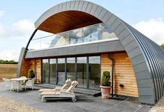 Located on rural farmland in Essex, the old, elongated structure has been reborn as The Zinc House, a contemporary, five-bedroom family home updated with a beautiful zinc roof and various sustainable features. Metal Building Homes, Metal Homes, Building A House, Building Ideas, Green Building, Building Plans, Building Materials, Hut House, Dome House