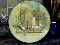 Flat, round, shallow tin box and its beautiful. The graphics are so pretty, clear and bright. It is about 8.5in wide and is only 1.25in tall. I