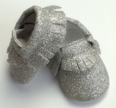 "Glitter Moccasins for Baby. Sizin(approximate): 0-3m = 4"" 3-6m = 4.5"" 6-12m - 4.75"" 12-18m = 5""-5.25"" 18-24m: = 5.50"""