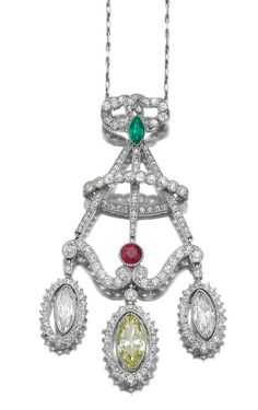 EMERALD, RUBY AND DIAMOND PENDANT NECKLACE, CIRCA 1900. Of chandelier design, millegrain-set with circular- and single-cut diamonds, accented with a marquise-shaped emerald and a circular-cut ruby, suspending three swing-set marquise-shaped diamonds, the central diamond of yellow tint, to a fine link chain, length approximately 440mm, fitted case stamped Boin-Taburet, Paris.