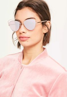 7cc969e3c57 Look fierce with these rose gold metal frame sunglasses with cat eye shaped  lenses. Gold