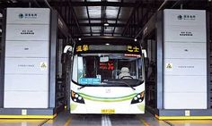 An electric bus parked at a battery replacement station in Qingdao, Shandong Province Thursday. The local government put 50 new electric buses on commercial routes in the city Thursday.