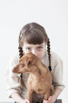 Who's cuter? the kid or the dog?