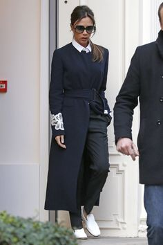 Victoria Beckham Works A Tailored Monochrome Coat And Collar With White Slip-On Shoes, 2016