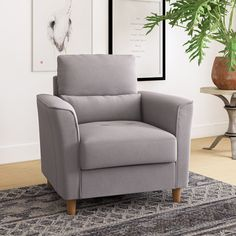 Perfect for curling up with a good book or spreading out while you watch a movie, an armchair like this is a great option for creating a cozy nook or additional seating in any living space. Living Spaces, Living Room, Cozy Nook, Curling, Good Books, Small Spaces, Georgia, Accent Chairs, Armchair
