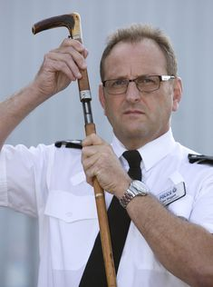 Assistant Chief Constable Ian Wiggett with a shotgun disguised as a walking… Wooden Walking Sticks, Walking Sticks And Canes, Walking Canes, Revolver, 410 Shotgun, Cane Sword, Manchester Police, Cane Stick, Firearms