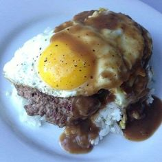 Loco Moco is island fast food. A hamburger patty is served on a bed of rice, then topped with an ove... - Flickr/ arnold | inuyaki