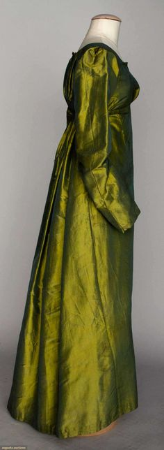 Green and gold silk gown, 1815-1825. I can really picture this on Cassandra in The Time Baroness http://www.amazon.com/The-Time-Baroness-ebook/dp/B004VGVSJ6