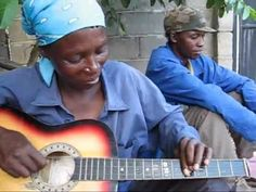 A lady busking in Botswana plays the guitar in a unique and amazing way! Not the pineapples for sale scrawled on her guitar! Brilliant!