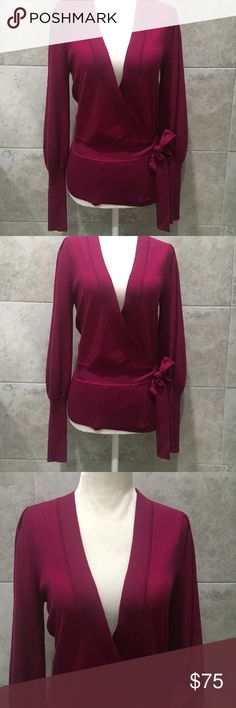 Diane Von Furstenberg wrap sweater merino wool Looks new!! Barely worn!! Beautiful Merino Wool wrap around sweater Diane Von Furstenberg Sweaters
