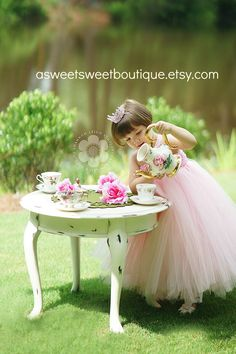 I want to do this shoot with a little girl!!! How precious. I have the tea pot and one cup/saucer... now to find 3 more ;)