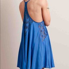 Dancing in Belize Trapeze dress Worn once, and gorgeous! Size large, bought on Threadsence for $85 and it's SOLD OUT! Price is firm on this piece. A summer must-have, this blue trapeze dress features sheer lace panels at the sides, back, and straps. Complete with a racerback design and a flowy silhouette, this sexy dress is perfect for a beach house party or a weekend getaway. Partially lined. Threadsence Dresses