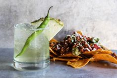 Spicy Seahawks Margarita - Living in Seattle has been amazing and we are lucky to have an amazing football team here that inspired todays cocktail. I created this chili and pineapple Margarita and paired it with the ultimate party food; nachos! Take your next game day party up a notch with a Spicy Seahawks Margarita and loaded nachos to match!