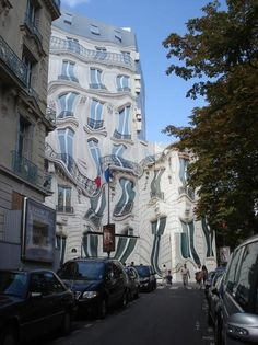 Surrealist Trompe l'Oeil by Pierre Delavie who covered a building at 39 Avenue Beroge V, Paris with a vast painted canvcas!