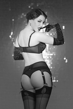 Black and white lingerie pinup showing off a shapely booty.