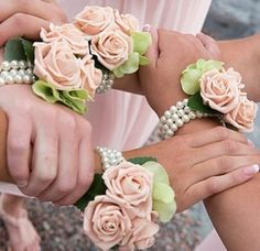 These wedding accessories wrist corsages are beautiful alternatives to bridesmaids bouquets