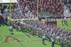 Texas A & M University Aggies tradition - football team gameday entering stadium and greeted by the ( senior ) boot line