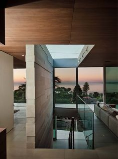 Contemporary hillside home floats above its site in La Jolla