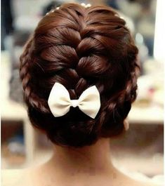 braided crown accented with a white small bow