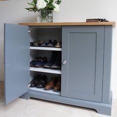 A simple slimline shoe cupboard with shaker style doors, a solid oak top and two internal shelves.Colour matched as standard to one of the following colours: Scree, Lime White, Pavilion Grey, Hardwick White, Pointing, City Grey and French Grey Bespoke colours can be matched at an extra £30 per piece.This slimline cupboard is an adaptation of our Pilsley range. The design includes a lowered plinth to give more internal height and we have utilized the extra height to include to shelves ....
