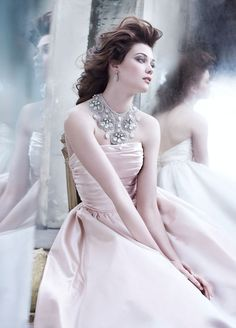 stunning look with a messy hair do, simple elegant dress and an elaborate diamond set