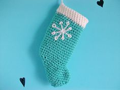 Learn how to make a cute stocking to hang up in your home for the holidays!