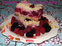Mascarpone Berry Cheesecake Bars-  Buttery crust, tangy raspberries and blackberries and a rich, creamy mascarpone filling combine to make some killer cheesecake bars.  http://www.fromcupcakestocaviar.com/2013/05/10/berry-mascarpone-cheesecake-bars/