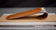 Leather pencil case with light gray felt interior