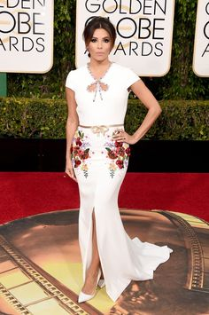 Newly engaged Eva Longoria tried out bridal white in a George Hobeika dress with intricate beading, an open back and bow details. See more of the Golden Globes' best dressed stars here!