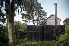 Black House in The Forest by Marchi Architectes | Yellowtrace