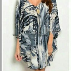 NWT abstract dolman tunic Indigo blue,  grey, white abstract tunic with dolman sleeves.  Lined,  quality poly blend. Tops Tunics