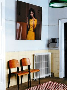 Prouvé Chairs - Photo on wall by Erwin Olaf