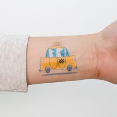 Temporary tattoos in the image of a yellow taxi is beyond cool. Honk.