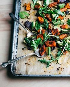 A roasted carrot salad recipe, made with savory spice-roasted carrots, lemony avocado, and young greens.