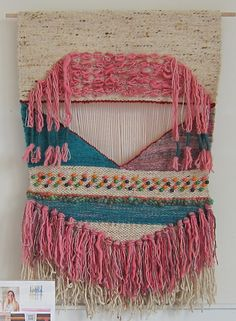Spun Studios woven tapestry wall hanging. The purchase of this piece helps a woman take greater control over her life.