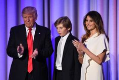 TOPSHOT - US President-elect Donald Trump arrives with his son Baron and wife Melania at the New York Hilton Midtown in New York on November 8, 2016. .Trump stunned America and the world Wednesday, riding a wave of populist resentment to defeat Hillary Clinton in the race to become the 45th president of the United States. / AFP / SAUL LOEB