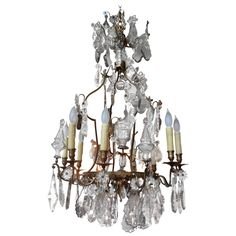 Antique French Eight Light Bronze and Crystal Chandelier | From a unique collection of antique and modern chandeliers and pendants at…