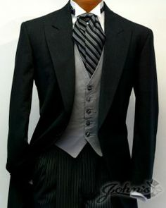 """Dark Grey Cutaway Tuxedo The cutaway tailcoat is the centerpiece for the dress code known as """"Morning Dress"""", intended for daytime formal occasions. The Cutaway features a single breasted, one-but… Groom And Groomsmen Attire, Bride And Groom Gifts, Sharp Dressed Man, Well Dressed Men, Wedding Suits, Wedding Attire, Wedding Tuxedos, Dress Suits, Men Dress"""