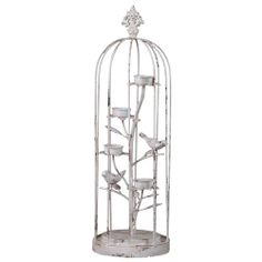 Add an air of vintage elegance to any room or home with this beautiful candle holder. Shaped in the delicate arches of a bird cage, this is sure to catch the eye of any guest.